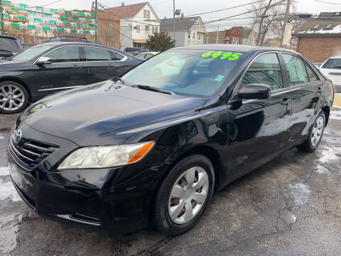 2009 Toyota Camry for sale at Barnes Auto Group in Chicago IL