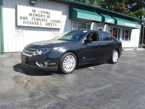 2011 Ford Fusion Hybrid for sale at GRESTY AUTO SALES in Loves Park IL