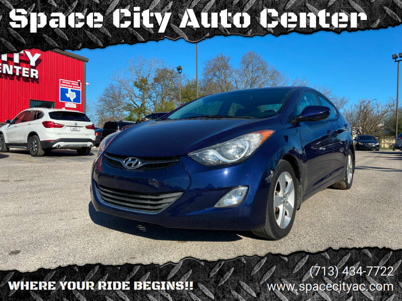 2013 Hyundai Elantra for sale at Space City Auto Center in Houston TX