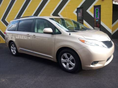 2014 Toyota Sienna for sale at MIRACLE AUTO SALES in Cranston RI