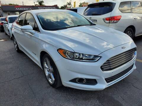 2014 Ford Fusion Hybrid for sale at America Auto Wholesale Inc in Miami FL