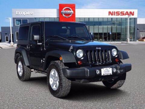 2012 Jeep Wrangler for sale at EMPIRE LAKEWOOD NISSAN in Lakewood CO