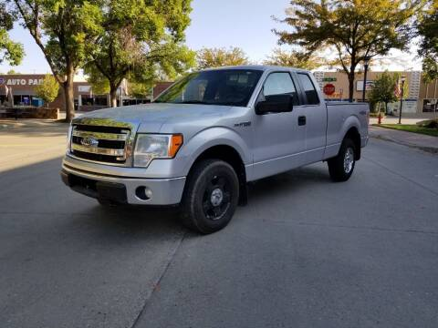 2014 Ford F-150 for sale at KHAN'S AUTO LLC in Worland WY