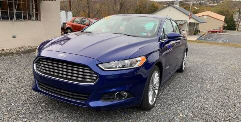 2013 Ford Fusion Hybrid for sale at JM Auto Sales in Shenandoah PA