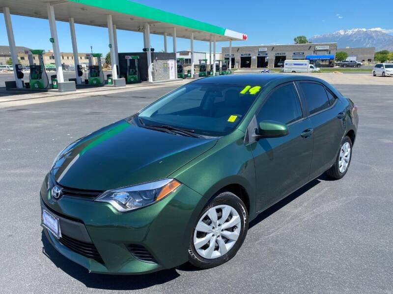 2014 Toyota Corolla for sale at Evolution Auto Sales LLC in Springville UT