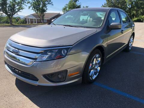 2010 Ford Fusion for sale at DRIVE N BUY AUTO SALES in Ogden UT