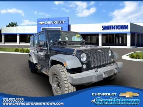 2016 Jeep Wrangler Unlimited for sale at CHEVROLET OF SMITHTOWN in Saint James NY