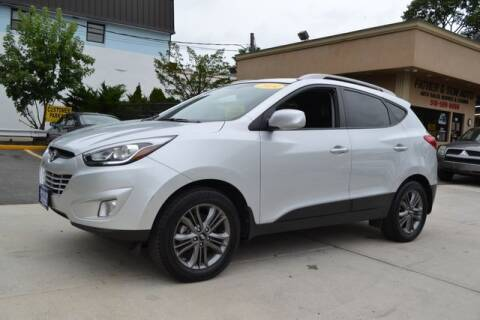 2014 Hyundai Tucson for sale at Father and Son Auto Lynbrook in Lynbrook NY