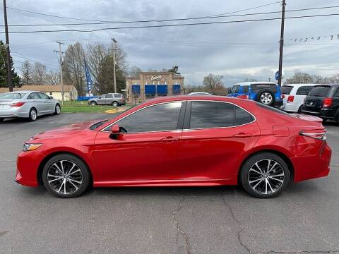 2019 Toyota Camry for sale at Car Zone in Otsego MI