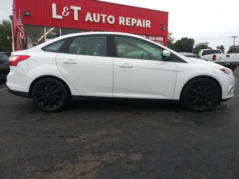 2014 Ford Focus for sale at L&T Auto Sales in Three Rivers MI