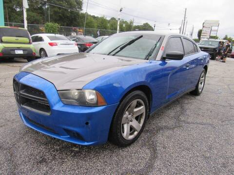 2013 Dodge Charger for sale at King of Auto in Stone Mountain GA