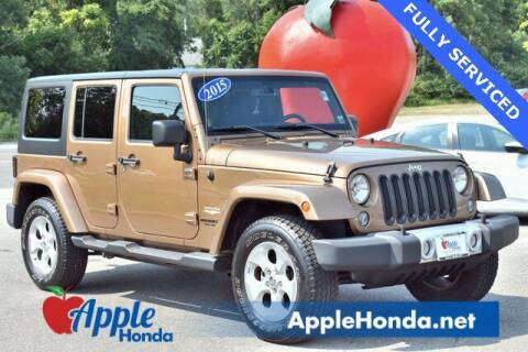 2015 Jeep Wrangler Unlimited for sale at APPLE HONDA in Riverhead NY