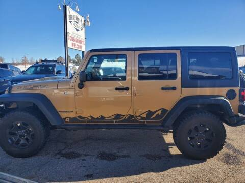 2013 Jeep Wrangler Unlimited for sale at BERKENKOTTER MOTORS in Brighton CO
