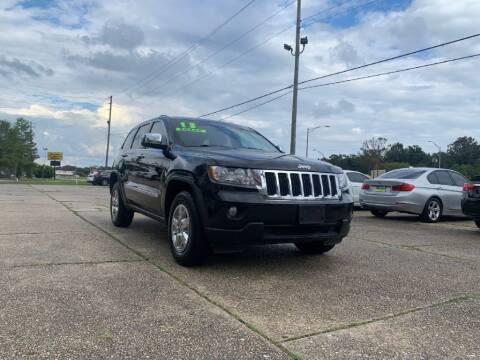 2013 Jeep Grand Cherokee for sale at Exit 1 Auto in Mobile AL
