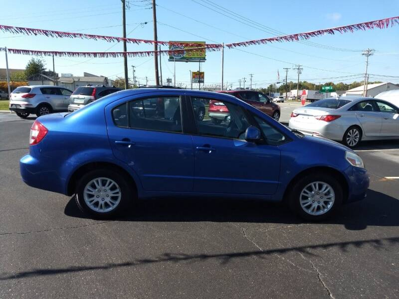 2013 Suzuki SX4 for sale at Kenny's Auto Sales Inc. in Lowell NC