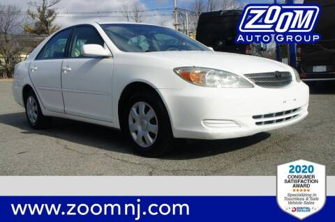 2002 Toyota Camry for sale at Zoom Auto Group in Parsippany NJ