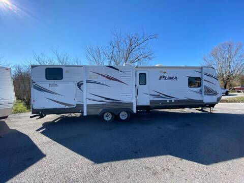 2015 PALOMINO BY FOREST RIVER PUMA 32DBKS for sale at MCCROSKEY AUTO & RV in Bluff City TN