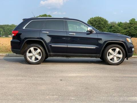 2011 Jeep Grand Cherokee for sale at Tennessee Valley Wholesale Autos LLC in Huntsville AL