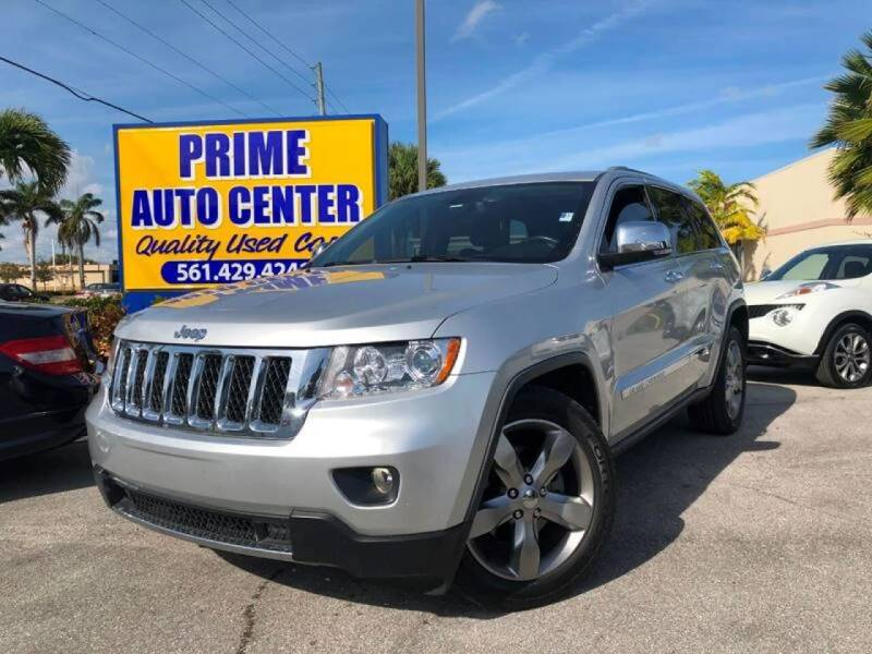 2011 Jeep Grand Cherokee for sale at PRIME AUTO CENTER in Palm Springs FL