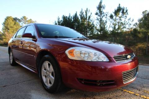 2009 Chevrolet Impala for sale at Oak City Motors in Garner NC