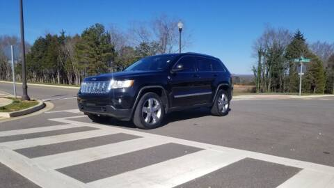 2012 Jeep Grand Cherokee for sale at Tennessee Valley Wholesale Autos LLC in Huntsville AL