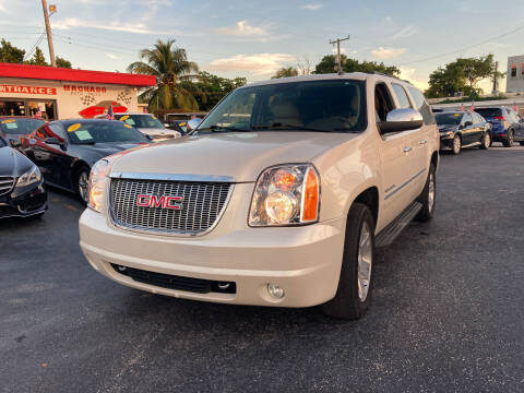 2012 GMC Yukon XL for sale at MACHADO AUTO SALES in Miami FL