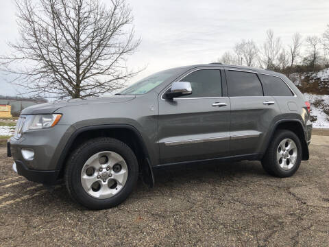 2011 Jeep Grand Cherokee for sale at Jim's Hometown Auto Sales LLC in Byesville OH