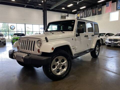 2013 Jeep Wrangler Unlimited for sale at CarNova in Sterling Heights MI