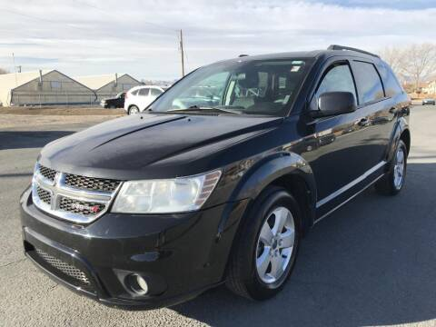 2012 Dodge Journey for sale at INVICTUS MOTOR COMPANY in West Valley City UT