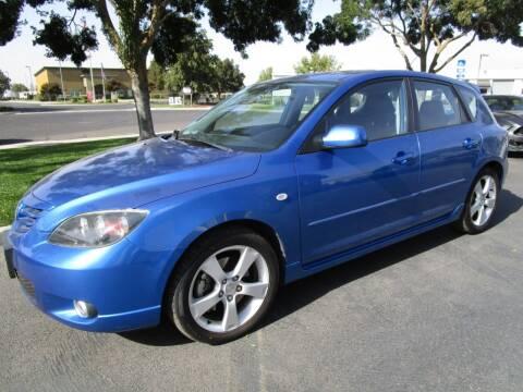 2004 Mazda MAZDA3 for sale at KM MOTOR CARS in Modesto CA