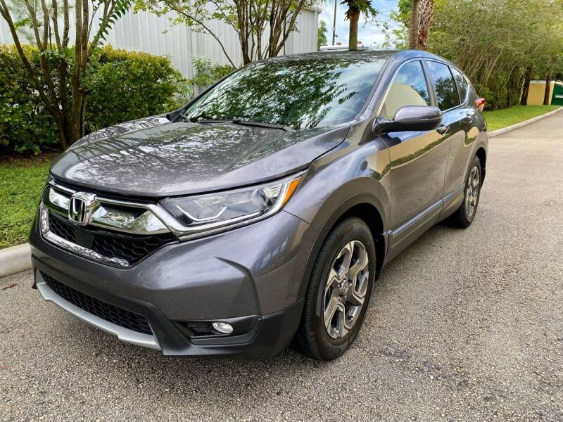 2018 Honda CR-V for sale at DENMARK AUTO BROKERS in Riviera Beach FL