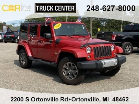2014 Jeep Wrangler Unlimited for sale at Carite Truck Center in Ortonville MI