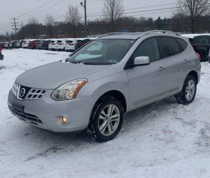 2013 Nissan Rogue for sale at Newport Auto Group in Austintown OH