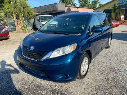 2011 Toyota Sienna for sale at Velocity Autos in Winter Park FL