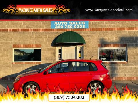 2009 Kia Spectra for sale at VAZQUEZ AUTO SALES in Bloomington IL