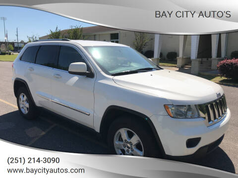 2011 Jeep Grand Cherokee for sale at Bay City Auto's in Mobile AL