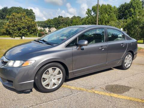 2009 Honda Civic for sale at WIGGLES AUTO SALES INC in Mableton GA