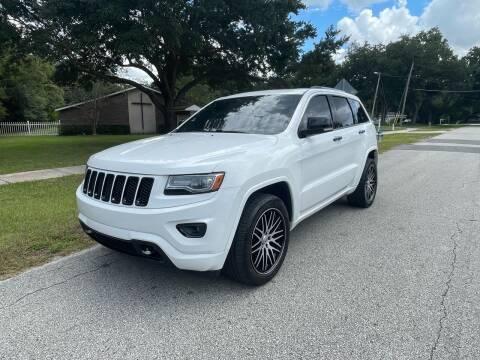 2014 Jeep Grand Cherokee for sale at P J Auto Trading Inc in Orlando FL