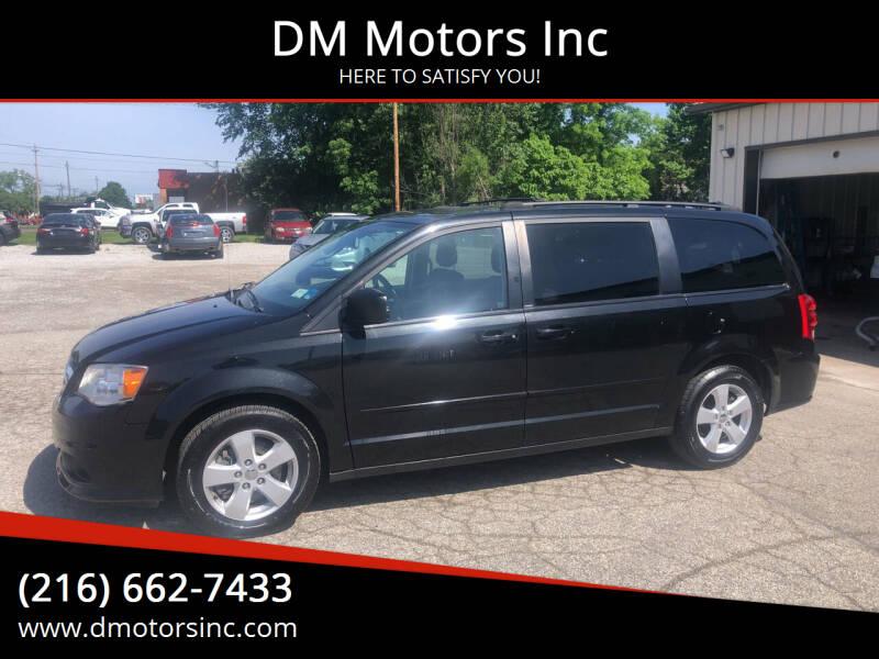 2013 Dodge Grand Caravan for sale at DM Motors Inc in Maple Heights OH