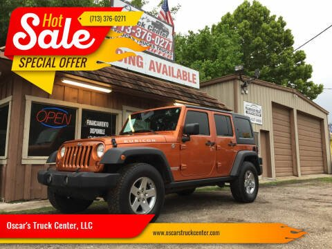 2011 Jeep Wrangler Unlimited for sale at Oscar's Truck Center, LLC in Houston TX
