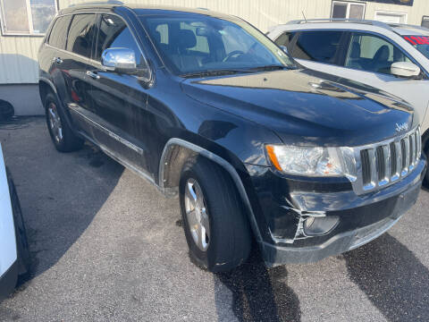 2012 Jeep Grand Cherokee for sale at BELOW BOOK AUTO SALES in Idaho Falls ID