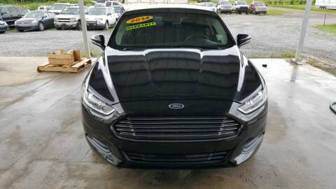 2014 Ford Fusion for sale at Auto Guarantee, LLC in Eunice LA