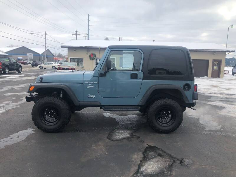 1999 Jeep Wrangler for sale at Mike's Budget Auto Sales in Cadillac MI