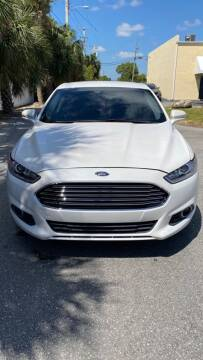 2013 Ford Fusion for sale at MLG Auto Group Inc. in Pompano Beach FL