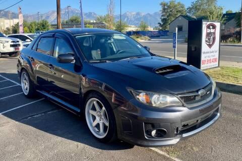 2011 Subaru Impreza for sale at The Car-Mart in Murray UT