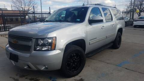 2012 Chevrolet Suburban for sale at Julian Auto Sales, Inc. in Warren MI