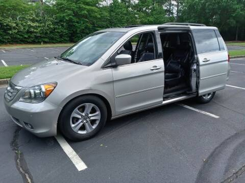 2009 Honda Odyssey for sale at Magwood Auto Dealers LLC in Jonesboro GA