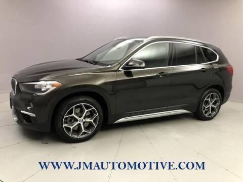 2018 BMW X1 for sale at J & M Automotive in Naugatuck CT