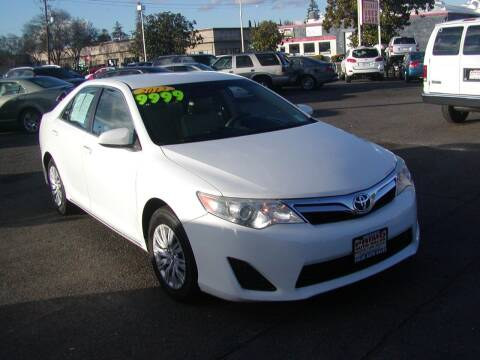 2012 Toyota Camry for sale at Primo Auto Sales in Merced CA