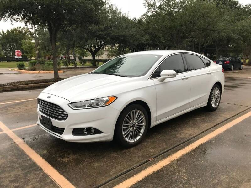 2014 Ford Fusion for sale at Mid-Town Auto in Houston TX